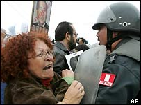 Relatives of those killed by paramilitary police protest outside the Peru court