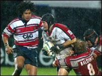 David Humphreys is grabbed by Gloucester's Adam Balding