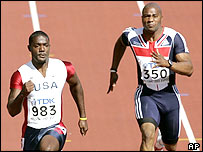 Justin Gatlin beat Mark Lewis-Francis in the 100m heats in Helsinki