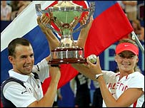 Dominik Hrbaty and Daniela Hantuchova lift the Hopman Cup