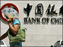 Woman outside Bank of China's HQ in Beijing