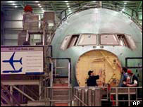 A Boeing jet under construction, AP