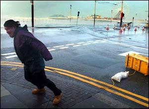 A man in high winds on the seafront at Blackpool