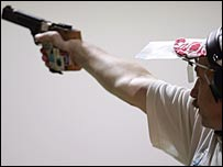 Russia's Sergei Alifirenko in action in the men's 25 metre rapid fire pistol event at the Athens Olympics