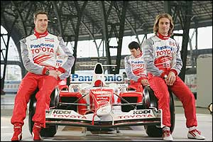 Toyota's Ralf Schumacher, Oliver Panis and Jarno Trulli sit on a F1 car