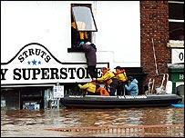 Rescuers evacuating a man