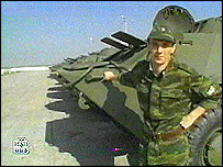 Russian soldier beside APC