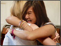 Annabel Lee (right) hugs her friend after attaining 5 A-Level passes in her results at King Edward VI Handsworth School, Birmingham