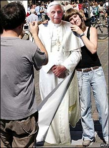 Woman poses with cardboard Pope