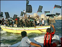 Islamic Jihad militants wave flags at sea rally to celebrate Gaza withdrawal near Gaza City