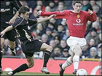 Manchester United's David Jones challenges Exeter's Marcus Martin
