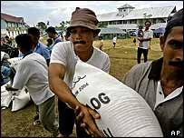 Volunteers unload bags of rice at a refugee centre on the outskirts of Banda Aceh, Indonesia.