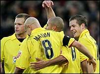 Watford players congratulate goalscorer Heidar Helguson
