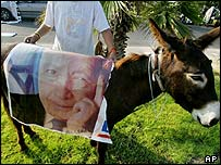 Settler in Elei Sinai puts Ariel Sharon poster on donkey as an insult