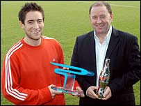 Lee Johnson receives his award from his father and manager Gary Johnson