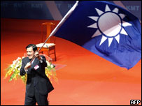 Ma Ying-jeou waves the Kuomintang party (KMT) flag