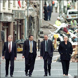 Mo Mowlam walks down the main street in Omagh in August 1998 with unnamed officials