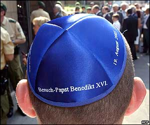 A boy wearing a commemorative skullcap