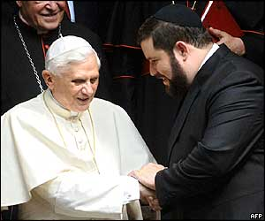 Pope Benedict is greeted by Cologne's Rabbi Netanel Teitelbaum