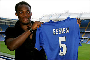 Michael Essien holds up his new Chelsea shirt
