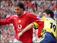 Ruud van Nistelrooy (left) tangles with Liam Ridgewell