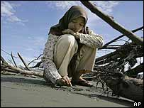 A 13-year-old Acehese girl who lost her parents and a sister in the tsunami