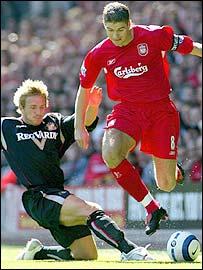 Liverpool midfielder Steven Gerrard is tackled by Sunderland's Liam Lawrence