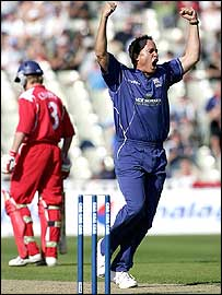 Neil Carter celebrates one of his four wickets