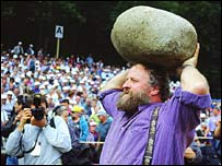Man hurling the Unspunnen stone  (Photo courtesy of www.unspunnenfest.ch)