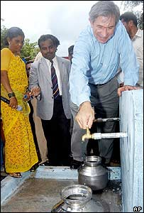 World Bank president Paul Wolfowitz turning on a tap during his visit to India