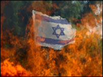 Flames from a burning barricade at the Katif settlement in the Gaza Strip