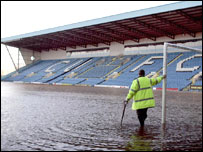 A groundsman looks out across Carlisle United's Brunton park pitch