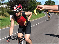 A cyclist is handed a banana from a steward (pic courtesy of Trevor Bevins)