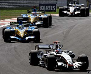 Kimi Raikkonen leads Giancarlo Fisichella and Fernando Alonso