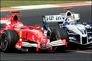 Michael Schumacher collides with Mark Webber