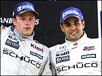 Montoya (right) puts his on brave face after his third place behind team-mate Kimi Raikkonen