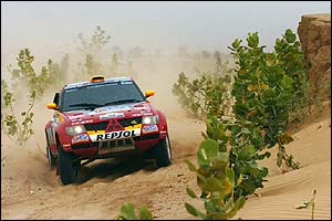 Stephane Peterhansel drives his Mitsubishi during stage 11