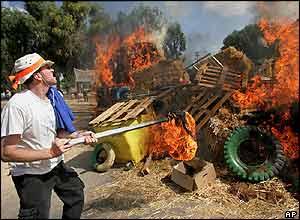 A man sets a barricade on fire at Katif