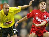 Watford's Paul Devlin (left) tussles with Liverpool's Steven Gerrard
