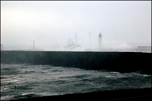 A trawler is engulfed as makes it into a stormy Anstruther Harbour. Picture by John Montgomery, Anstruther