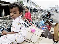 Survivor of tsunami waits for her family in Banda Aceh, Indonesia