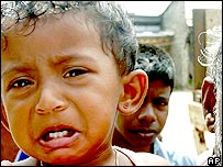 A child lines up for food in a camp at Paddiruppu, Sri Lanka
