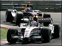 Jenson Button ahead of David Coulthard's Red Bull, one of his victims in Turkey