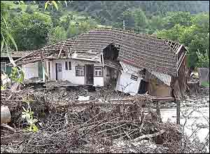 Collapsed house in Comanesti, Romania (pic: Vic Brown)