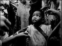 Child surrounded by militiamen