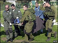 Israeli soldiers evacuate a wounded comrade after the attack on Morag