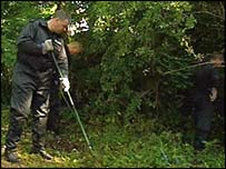 Police searching the woods