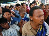 Migrants from Burma gather at an evacuation center in Takua Pa town in Phang Nga, Thailand