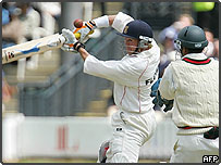 Andy Flower of Zimbabwe hits a ball bowled by Shane Warne