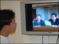 Khin Maung Win watching the new programme